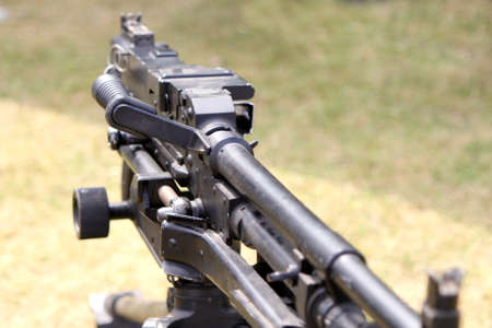 tripod mounted: Shallow focus shot of an L7A2 GPMG GIMPY General Purpose Machine Gun mounted on tripod