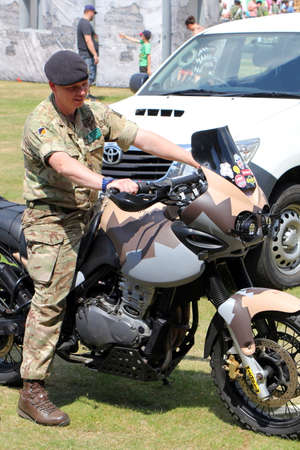 Sandhurst, Surrey, UK - June 18th 2017: British Army motorcyclist with Triumph motorbike at the Sandhurst Academy Open Day 2017 Editorial