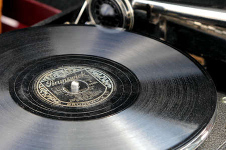 Sandhurst, Surrey, UK - June 18th 2017: Shallow focus close up of a dusty old Bing Crosby 78 vinyl record, on a vintage gramophone or record player