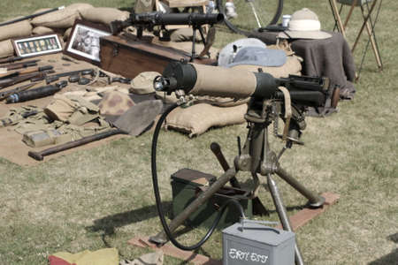 vickers: Sandhurst, UK - 18th June 2017: Vintage toned shot of a water cooled Vickers Machine Gun and other small arms at a military enactment fair
