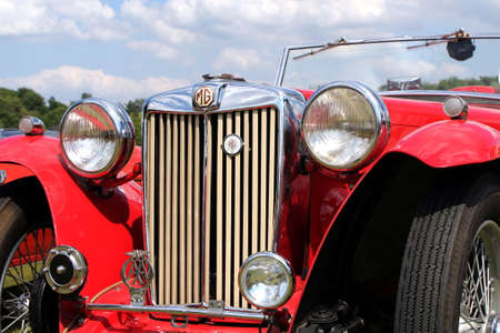 Sandhurst, UK - 18th June 2017: Closeup of the grille, lights and badges on a classic MG TA convertible sports car