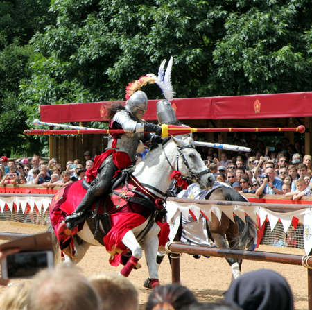 're: Warwick, UK - July 22 2017: Jousting tournament and medieval re-enactment of the Wars of the Roses at Warwick Castle Editorial