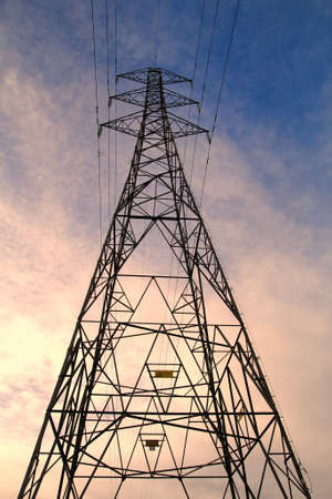 Electricity pylon or power gantry against a dramatic evening sky