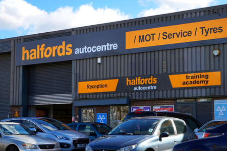 Basingstoke, UK - March 9th 2017: Exterior of the Halfords Autocentre MOT Service and Tyres centre Editorial