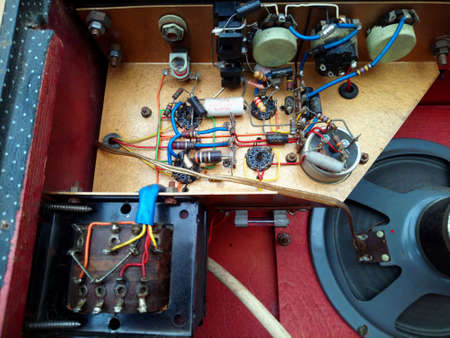 Camberley, UK - September 24 2017: Electronic components inside a vintage 1960s Watkins Electric Music (WEM) Westminster classic valve guitar amplifier