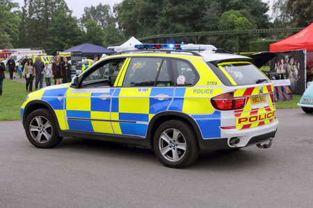 Beaulieu, Hampshire, UK - May 29 2017: BMW patrol car belonging to the UK Police Force with blue lights flashing attending an incident Editorial