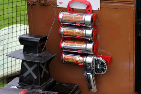 Beaulieu, Hampshire, UK - May 29 2017: WW2 Antifyre Pistole Fire Extinguisher gun with spare recharge cartridges