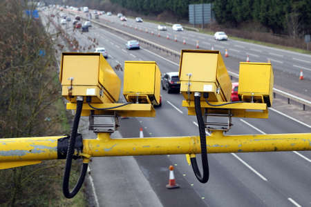Fleet, Hampshire, UK - March 11th 2017: Average speed cameras in operation on the M3 Motorway to reduce vehicle speed to safe limits in roadworks