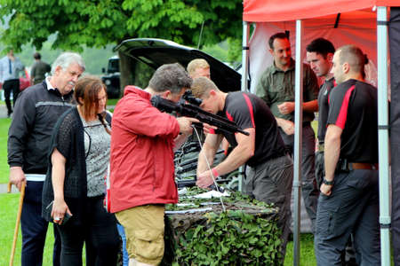 Beaulieu, Hampshire, UK - May 29 2017: Soldiers from the British Military Police demonstrating rifles and submachine guns to members of the public