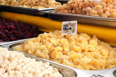 Dried fruit for sale on a French market, including Poire (pear). Stock Photo