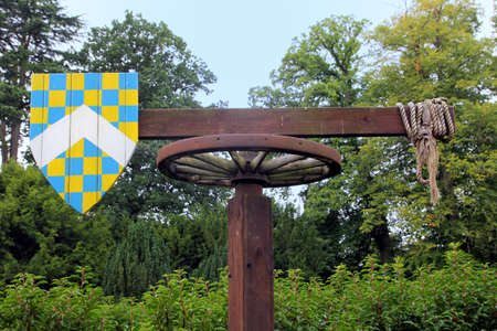 Medieval quintain with shield on a revolving post used for jousting practice. Stock Photo