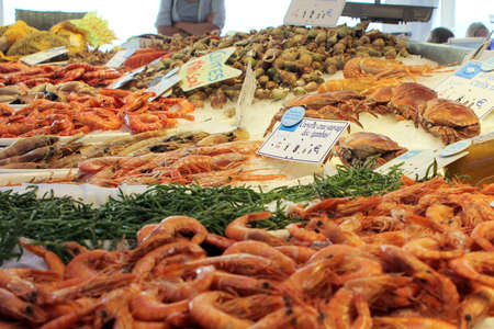 Valras-Plage, Herault, France - Aug 25 2017: Selection of raw and cooked shrimp, prawn and crab for sale in a French seafood store Editorial
