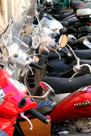 Sete, Herault, France  - Aug 21 2017: Crowded rows of motor scooters and motorcycles parked close together on a city street
