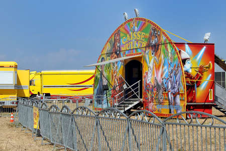 Valras-Plage, Herault, France - Aug 23 2017: Colourful decorated ticket office belonging to the French Cirque Muller, with trailers and trucks