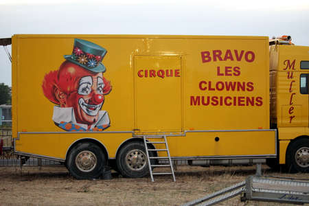 Valras-Plage, Herault, France - Aug 22 2017: Trailer belonging to a French circus or Cirque, with a large picture of a clown, advertising Bravo les Clowns Musiciens (Musical Clowns) Editorial