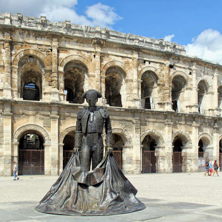 Nimes, Gard, France - Sep 02 2017: The statue of the matador Christian Montcouquiol (Nimeño II) in front of the Arena of Nimes, a Roman amphitheater built in 70 AD. Editorial