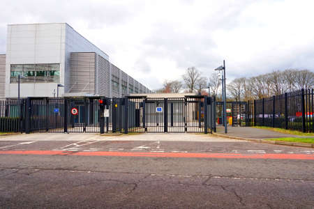 Basingstoke, UK - February 10 2016: Heavy security gates and barriers at the entrance to an out of town secure data storage facility Sajtókép