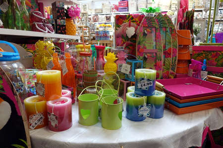 St Ives, Cornwall, UK - April 13 2018: Colourful homeware and decorative items for sale on shelves in a fancy goods store Editorial