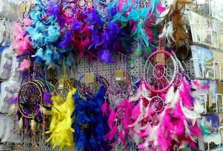 Padstow, Cornwall, April 11th 2018: Selection of multi colored feather dream catchers for sale in a souvenir shop Sajtókép