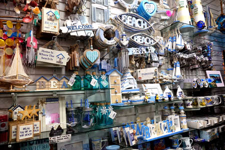 Padstow, Cornwall, April 11th 2018: Selection of seaside, beach or coast related gift items in a shop display Sajtókép