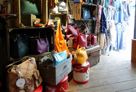 Padstow, Cornwall, April 11th 2018: Selection of handbags and other accessories, in a ladies fashion shop Editoriali