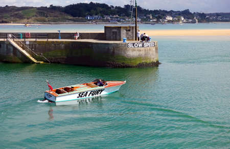 Padstow, Cornwall, April 11th 2018: Speedboat Sea Fury approaching the jetty in Padstow harbour in calm water on a sunny day Sajtókép