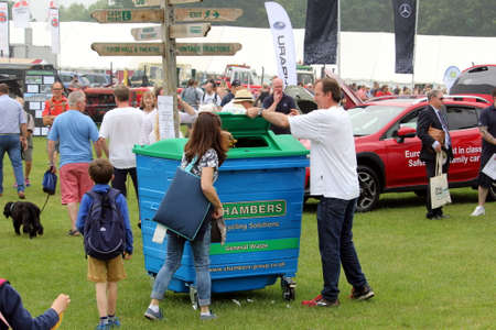 Guildford, England - May 28 2018: Visitors to a county agricultural farm show disposing of their rubbish or trash responsibly