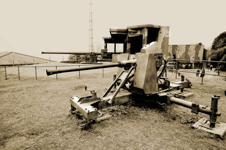 Falmouth, Cornwall, UK - April 12 2018: Old World War Two WW2 anti aircraft gun on display at Pendennis Castle in Cornwall