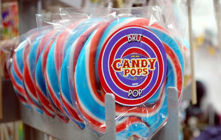 Padstow, Cornwall, April 11th 2018: Candy pops lollipops in red white and blue, for sale in a sweet shop