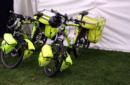 Guildford, England - May 28 2018: Two paramedic bicycles belonging to the St John Ambulance movement, a voluntary first aid medical organisation