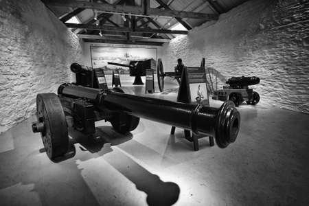 Falmouth, Cornwall, UK - April 12 2018: Several antique historical cannons on display at Pendennis Castle in Cornwall Sajtókép