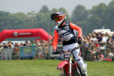 Guildford, England - May 28 2018: Stunt daredevil motorcycle rider, from the Bolddog Lings Freestyle Display Stunt Team, preparing to perform a stunt jump