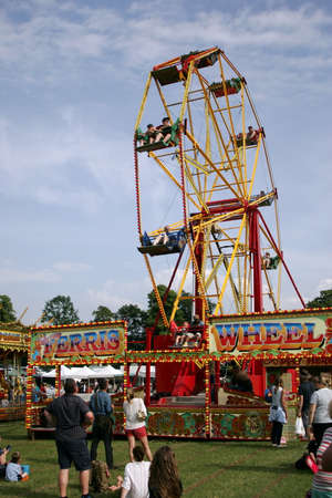 Guildford, England - May 28 2018: Traditional old fashioned vintage Ferris Wheel fairground ride on a summer day