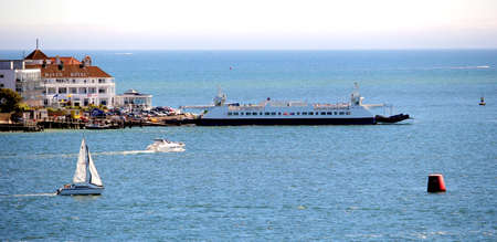 Sandbanks, Dorset, England - June 02 2018: Distant panoramic view of the Sandbanks Chain Ferry waiting on the Sandbanks side of the entrance of Poole Harbour near the Haven Hotel