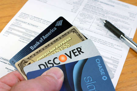 Palm Springs, California - August 23, 2011: Four credit cards with statement 에디토리얼