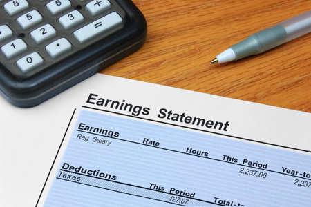 salarios: Estado de resultados Foto de archivo