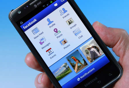 Palm Springs, California, USA - November 3, 2011: An AT&T Smartphone displaying Facebook homepage. Stock Photo - 11728498