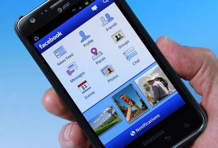 samsung galaxy: Palm Springs, California, USA - November 3, 2011: An AT&T Smartphone displaying Facebook homepage. Editorial