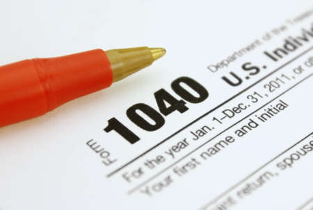 Form 1040 Income Tax Return with Red Pen