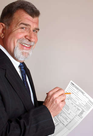 Smiling Tax Accountant with 1040 Income Tax Form photo