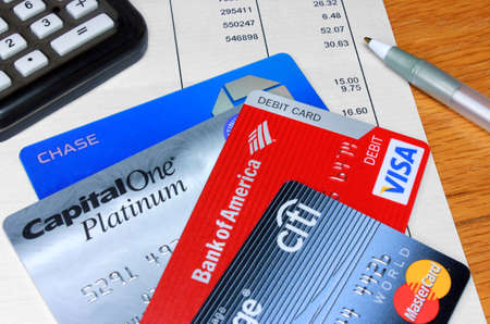 debt collection: Palm Springs, California, USA - February 9, 2012: Four Credit and Debit Cards