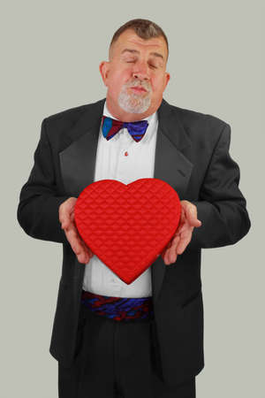Adult Man Offers a Kiss and Chocolates Stock Photo - 13111044