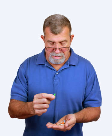Senior Adult Male with Pills Stock Photo