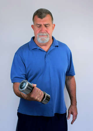 Adult Male Exercising with Dumbbell photo
