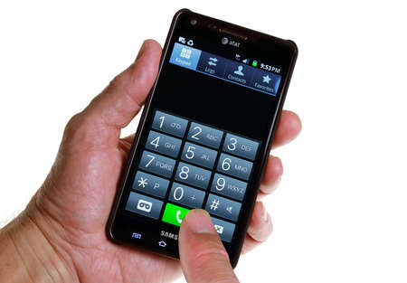 October 12, 2011 - An AT&T Smartphone touchscreen keypad with finger ready to make a call