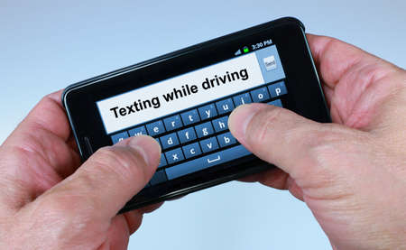Two Thumbs Texting While Driving Standard-Bild - 14558951