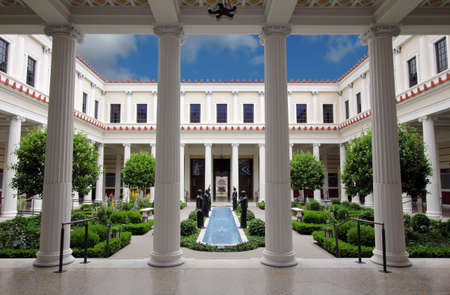 Pacific Palisades, California, USA - June 1, 2012: The Inner Courtyard of the Getty Villa, an educational center and museum dedicated to art and culture of ancient Rome, Greece, and Etruria.