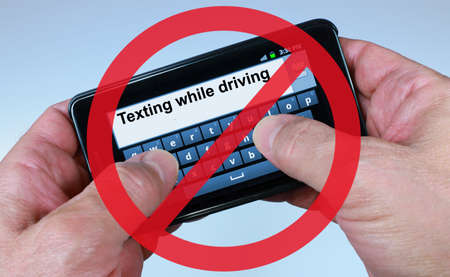 texting: No Texting While Driving Sign Stock Photo