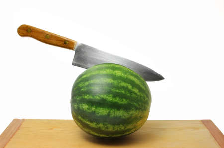 slicing: Knife in Seedless Watermelon Stock Photo