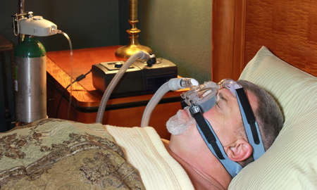 Adult Man Sleeping Peacefully with CPAP and Oxygen